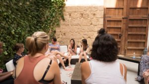 A mastermind session in the courtyard