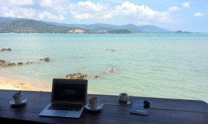 A laptop with a beach view on Koh Samui