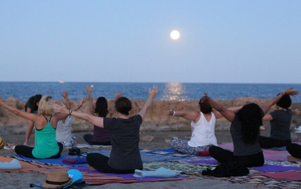 Moonlight yoga at the beach in Javea