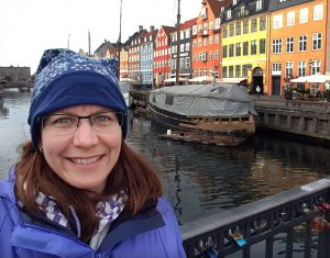 Lisa Collard, a social media manager snaps a selfie in front of some really colorful buildings in Denmark!