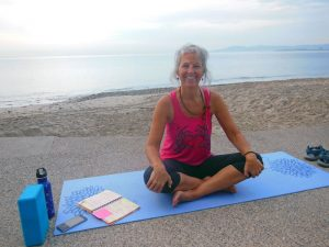Meet DNG Heidi - sitting on the yoga mat at the beach