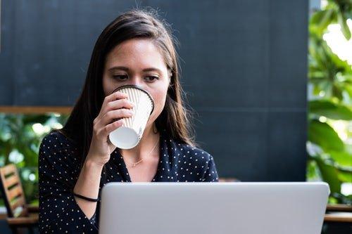woman coffee laptop digital nomad